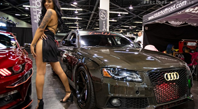 Paolapinks_ with Carbon Audi in the Klutchwheels booth at Spocom Anaheim