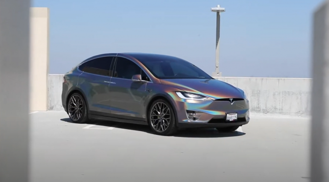 Tesla Model X with custom psychedelic gloss flip wrap rolling on Savini SV-F2 Wheels